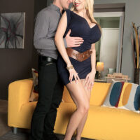 Huge jugged blonde Sandra Starlet is freed from a short sundress before sex on a chesterfield