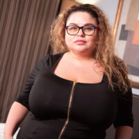 First-time BBW Anna Katz gets rid of her glasses before unleashing her massive boobies