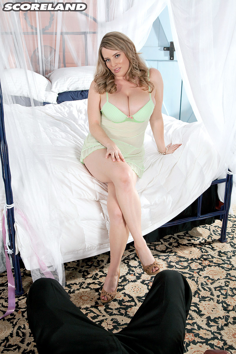 Busty light-haired MILF Maggie Green takes a massive cock in her hand during a POV episode