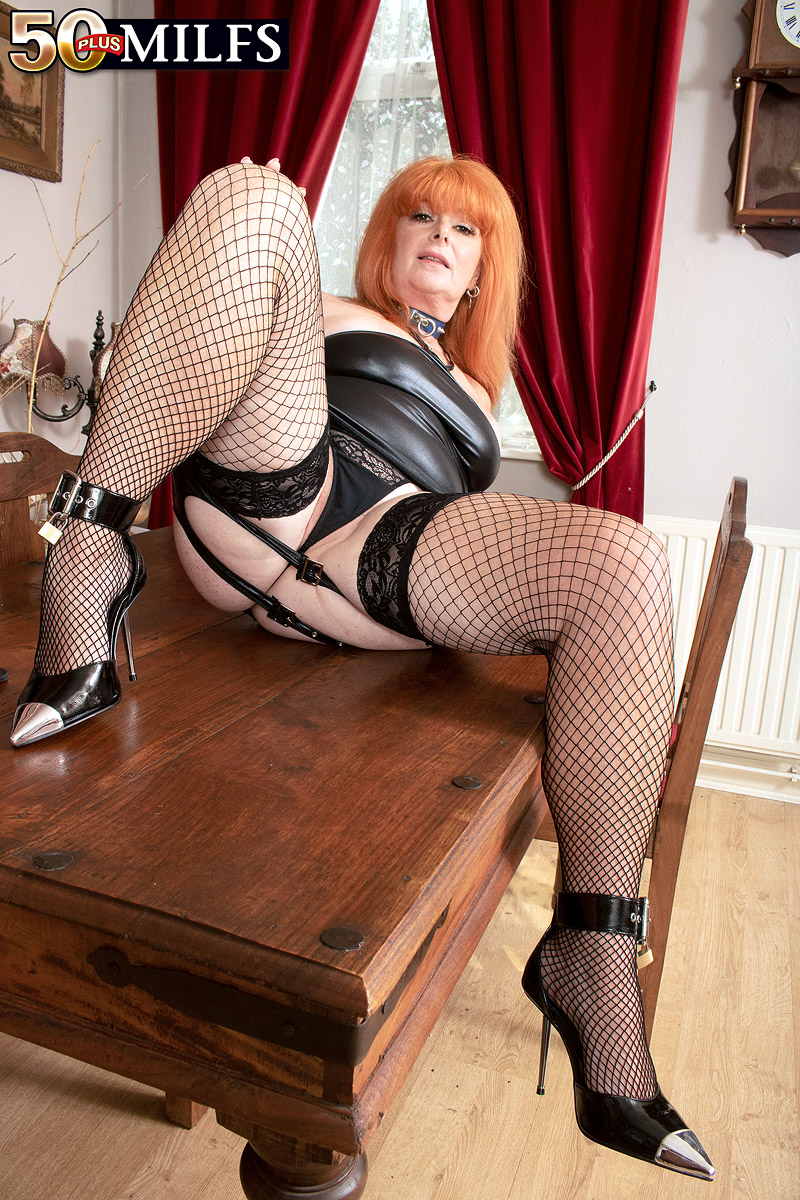 Chesty experienced redhead Melanie Taylor sports clothespins on nips while paddling her massive rump