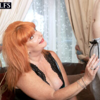 Redheaded cougar Melanie Taylor entices a younger stud in an ebony leather dress