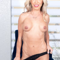 Uber-sexy mature blonde Mandy Monroe strips to her high heels during her first nude shoot