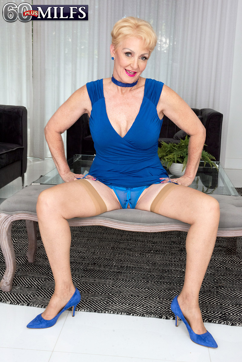 Yellow-haired granny with short hair Seka Black strips to tan nylons attired in a choker