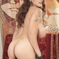 Inked solo model Mischel Lee revealing large boobies before losing granny skivvies