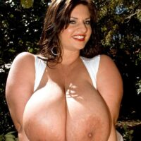 Brown-haired solo girl Maria Moore exposes her large melons outdoors in shorts