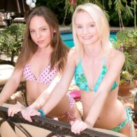 Teenaged lesbians Sammy Daniels and Aubrey Star peel off each others swimsuit while outdoors