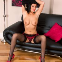 Aged brunette dame revealing her humungous boobies and mind-blowing ass in stockings and high-heels
