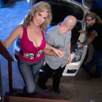 Buxom blond cougar Laura Layne seducing mechanics for an MMF 3some in a garage