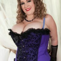 Overweight solo model Smiley Emma exposes her immense boobs in mesh nylons and arm socks