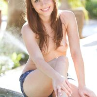 Enticing teenager Marissa exposes her puny breasts before freeing her tight rump from cut-offs