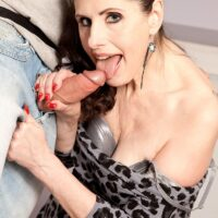Long-limbed cougar Lorenzia entices the handyman in a short sundress and tights