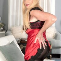 Yellow-haired nan Charlie seduces a younger boy in lingerie and ebony hose