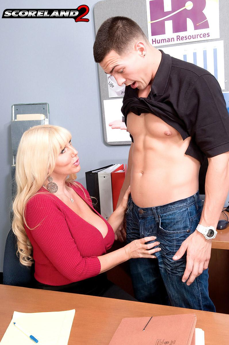 Sandy-haired boss woman Karen Fisher reveals her hefty titties while seducing a male employee