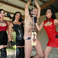 Cruel females with dark hair torture a male sub in latex and long boots