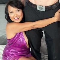 60 Plus Japanese MILF Mandy Thai wears no brassiere under her dress while seducing a dude