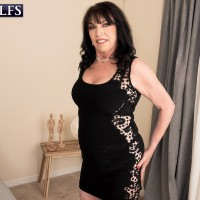 Sixty plus MILF Christina Starr tempts a young guy while going bra-less in a black sundress