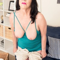 60 plus MILF Christina Starr exposes her sagging boobs as she gets downright naked
