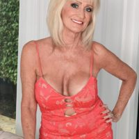 60 plus MILF Leah L'Amour entices a junior boy at the door with her monster-sized boobies out