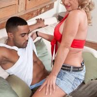 Elderly platinum-blonde doll Cali Houston loosing giant boobies while seducing junior boy