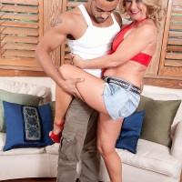 Elder blonde doll Cali Houston letting out gigantic knockers while seducing junior boy