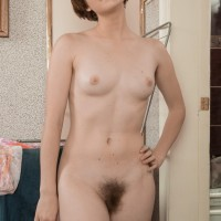 First timer female Aria wears her hair short while showing her petite titties and utter pubic hair