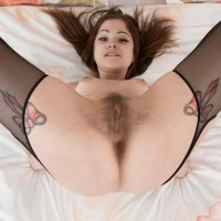 Amateur model Emanuelle demonstrates off her all-natural cunt in transparent stockings and garters
