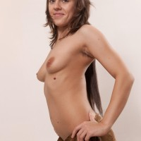Amateur babe Dominique unveils her natural tits before showing her unshaven fuckbox