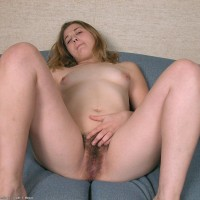 Amateur solo female gets nude and plays with her fur covered snatch