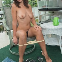 First-timer solo female Katie Z showcases her wooly pits and fuckbox on her balcony