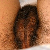 First timer solo girl with unshaven underarms set her full pubic hair free of panties on a bed