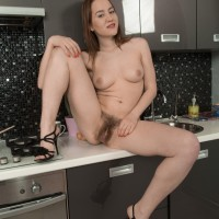 Amateur solo girl Yana Cey stretches her utter thicket after getting naked in the kitchen