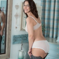 First-timer lady Kaysy showcases her cootchie after discarding see thru panties on a sofa
