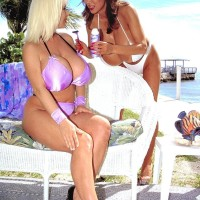 Oriental lezzy Minka and her enormous breasted wife suck hard nipples and tongue smooch outdoors