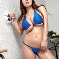 Oriental MILF Hitomi reveals her immense hooters from her bikini top in stilettos