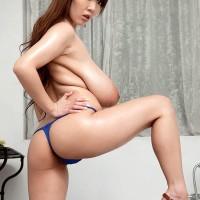 Oriental MILF Hitomi reveals her immense hooters from her bikini top in stilettos