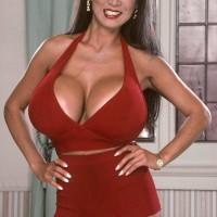 Asian MILF XXX flick star Minka unsheathing enormous titties from crimson dress in high heeled shoes