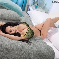 Chinese solo chick Hitomi models fully clothed in a boulder-holder and seductive bodystocking on a bed