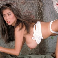 Japanese solo model Minka bares her hefty juggs from her boulder-holder army fatigues