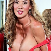 Chinese solo model Minka unleashes her hefty boobies from a red dress afore a mirror