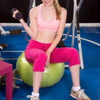 Athletic teenage Lily Rader uncovers her perky titties while working out in her undies