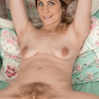 Barefoot first-timer Ashleigh McKenzie spreads her legs to play with her total bush