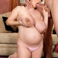 BIG SEXY WOMAN April McKenzie deep throats a large cock after having her humungous titties sucked on