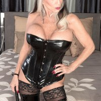 Giant jugged 60 plus MILF Sally D'Angelo wanks a dick in spandex boots and black corset