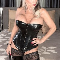 Enormous breasted 60 plus MILF Sally D'Angelo milks a hard-on in latex boots and ebony corset