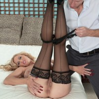 Huge boobed blond MILF Holly Claus giving immense penis blowjobs in ebony nylons