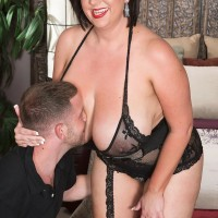 Hefty breasted dark haired Paige Turner providing hand-job after nipple sucking in tights