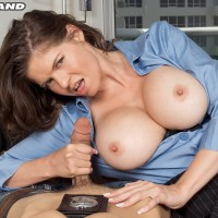 Humungous titted dark-haired policewoman June Summers giving hj to hefty penis