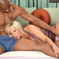 Large boobed grandma Alysha is freed from a short sundress by her younger ebony paramour