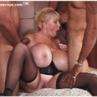 Giant boobed older fair-haired Kayla Kleevage partakes in an bi-racial group sex on her bed