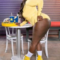 Ebony BBW Stacy Love flaunts her enormous butt in ass-cheeks cut-offs and roller skates